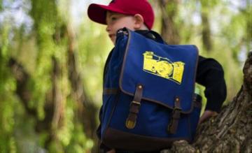 Description: boy a blue backpack