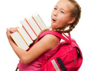Description: girl holding large stack of books